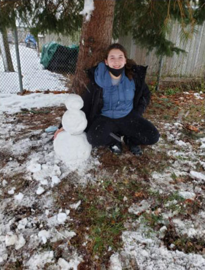 Girl with snow man