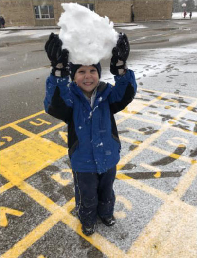 Boy with snow ball